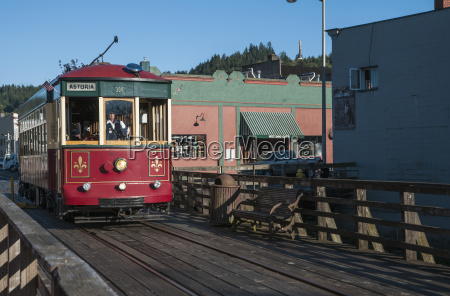 the astoria trolley carries passengers along