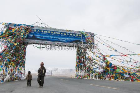 traditional tibetan flags on the mountain