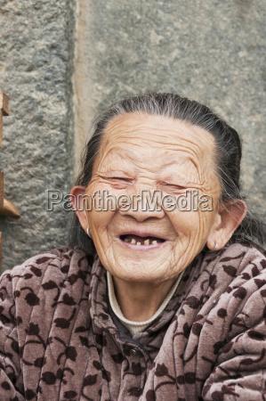 an old hakka minoritys woman laughing