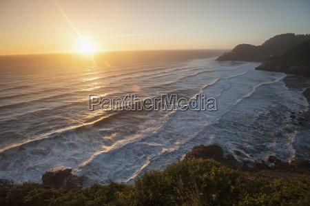 waves lapping the coast at dusk