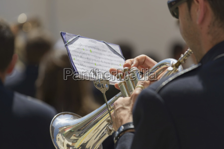 a man playing a trumpet with