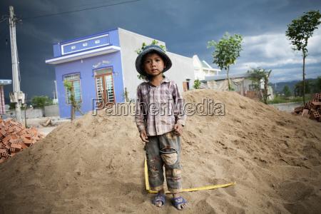 a hill tribe vietnamese boy plays