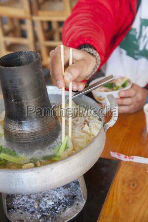 traditional naxi hot pot lijiang yunnan