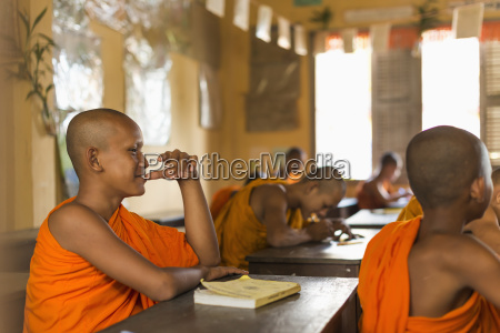 young monks attending their class in