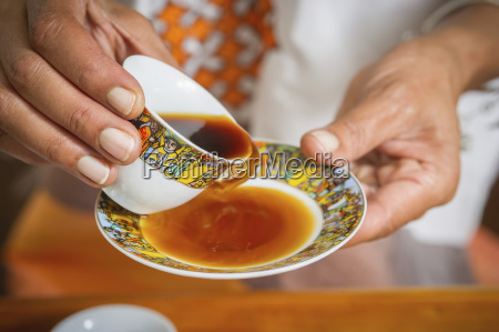 hands holding traditional ethiopian coffee cup