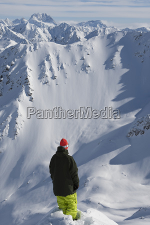 snowboarder looking over the edge of