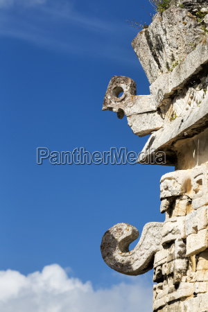 detailed stone carvings on side of