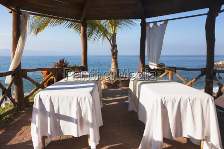 couples massage tables set up on