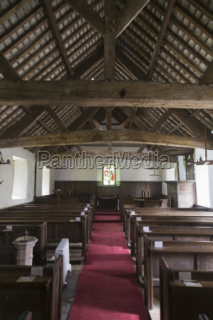 church with wooden pews and red