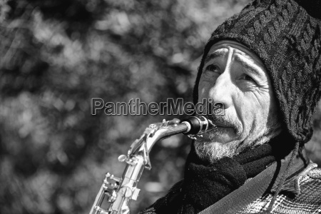 mono close up of bearded saxophonist