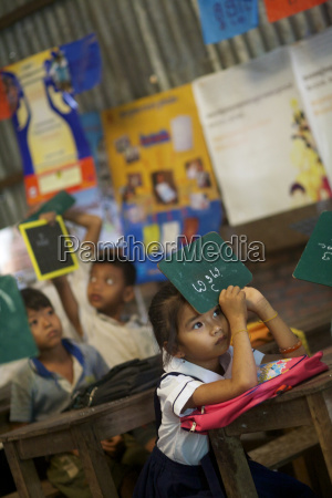 schoolgirl holding chalkboard upside down in
