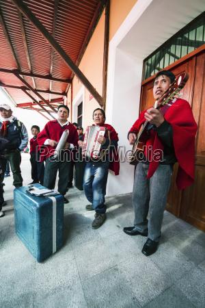 musical ensemble playing at the railway
