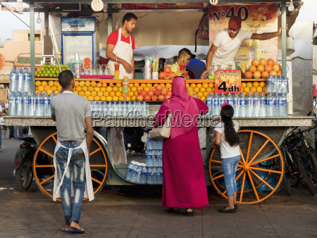 purchasing a fruit drink from a