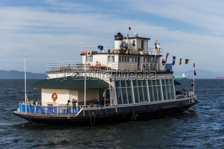 a historic ferry boat returns to