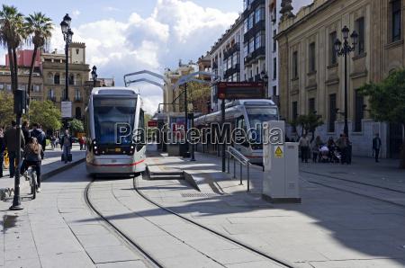 two modern trams stopped at santa