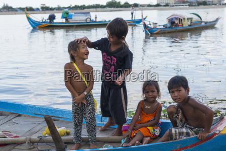 some kids playing on a boat