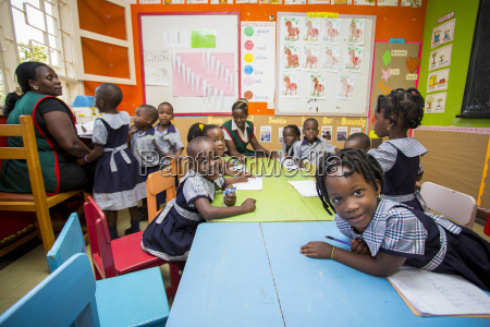 young children in a classroom with