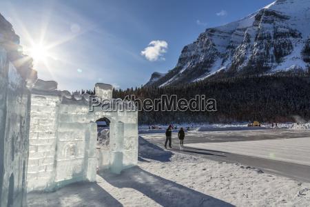 the sun shines behind an ice
