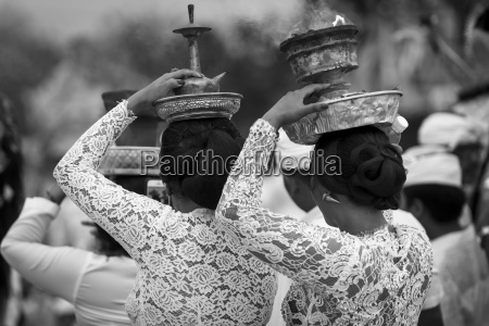 young women at a religious ceremony