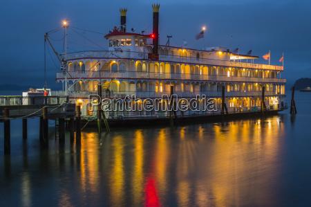 lights illuminating a river boat docked