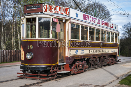 a, tram, with, advertisements, on, the - 25407746