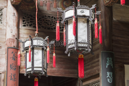 lamps hanging from the ceiling of