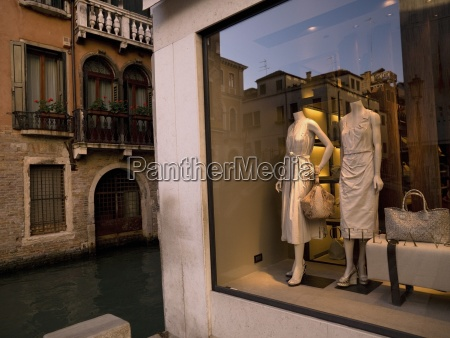 window display with mannequins next to