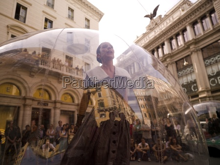 woman standing inside transparent glass globe