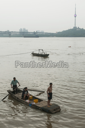 people on a small boat on