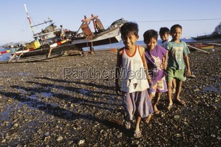 children on rocky beach bais negros