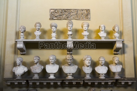 collection of sculptures of human heads