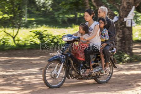 cambodian family riding a motorcycle beng