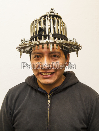 man wearing a haberdashers fitting instrument
