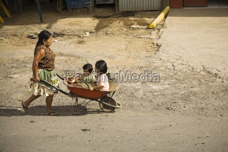 central america woman pushing her two