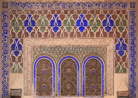 intricate painted and stucco patterns on