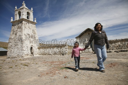 woman and daughter leaving church chile