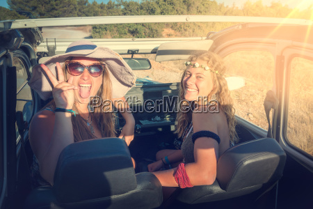 friends, in, a, car, at, sunset - 25412774