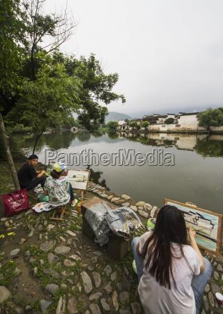 painters by nanhu lake hongcun anhui