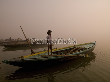 the ganges varanasi indiayoung girl standing