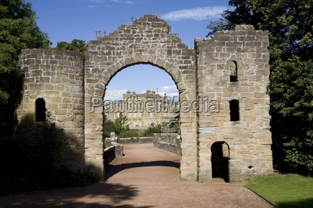 an archway leading to a large