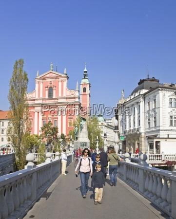 people walking over a bridge in