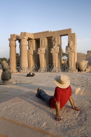man sitting at temple in luxor