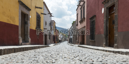 colourful buildings lining a cobblestone street