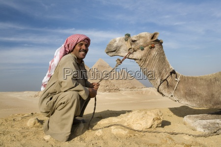 a man and camel with the