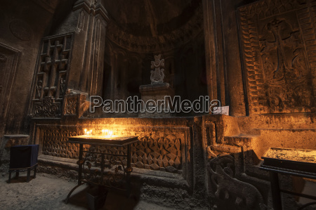 lit candles in the church in