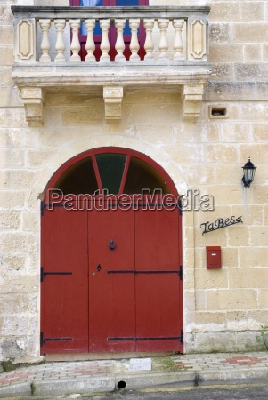 a red door on a stone