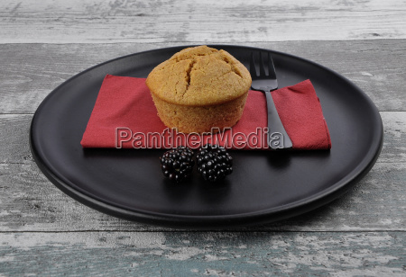 muffin on plates and weathered wood