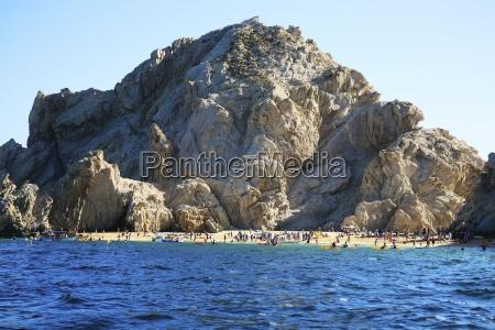 beach with mountain backdrop cabo san