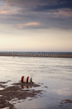 buoy on seashore