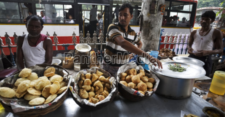indian men selling savoury snacks from